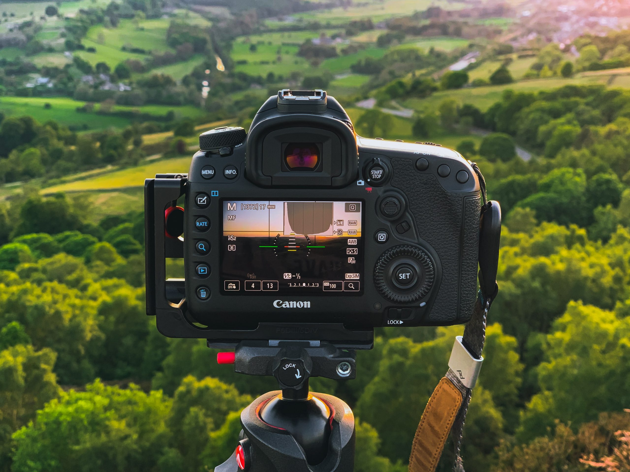 Camera looking across green rolling hills